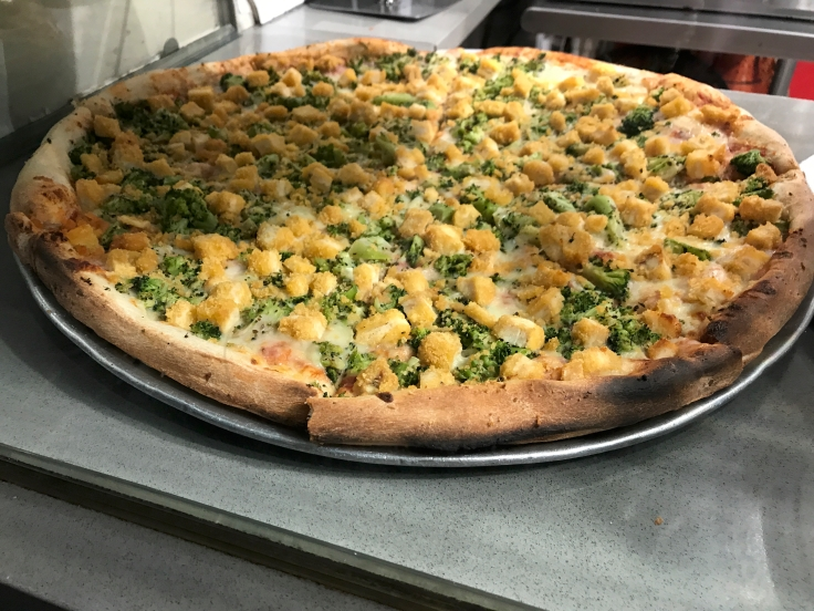 I Only Have Pies for You - A photo of broccoli and chicken slices at 2 Bros. Pizza restaurant in New York City, New York. Photo Courtesy of FoodWaterShoes