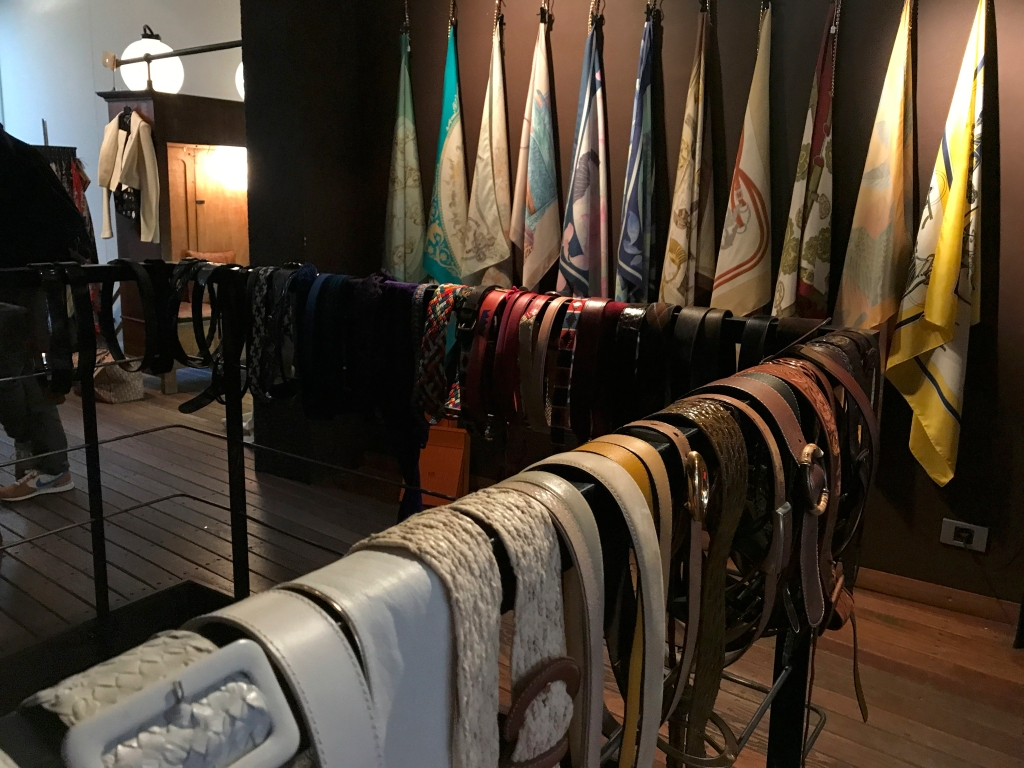 A photo of vintage silk Hermès scarves and pretty secondhand belts at Isabelle Bajart boutique in Brussels (Bruxelles), Belgium. Photo Courtesy of FoodWaterShoes