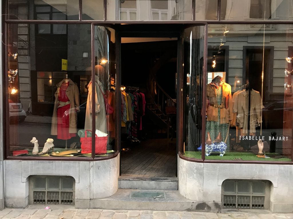 An exterior street view photo of the outside front of Isabelle Bajart, a hip cool local vintage secondhand clothing boutique store in Brussels (or Bruxelles), Belgium. Photo Courtesy of FoodWaterShoes.