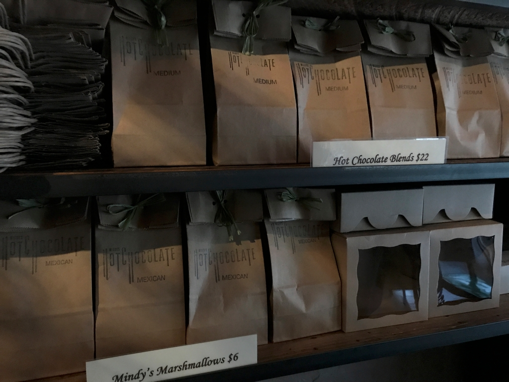A photo of packages of hot chocolate blends and homemade marshmallows to-go at local hot spot Mindy's Hot Chocolate Chicago in Chicago, Illinois. The Windy City based dessert restaurant serves brunch, cocktails, drinks, lunch and dinner. Photo Courtesy of FoodWaterShoes