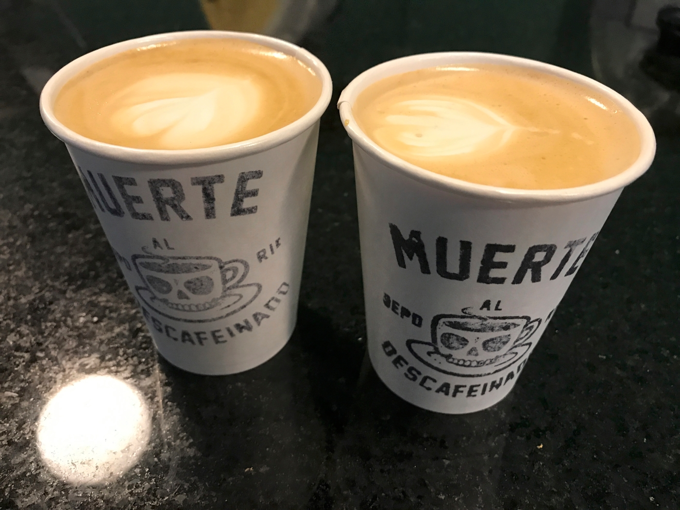 A photo of two delicious tasty hot cappuccinos at Nómade, a café in Montevideo, Uruguay. Photo Courtesy of FoodWaterShoes