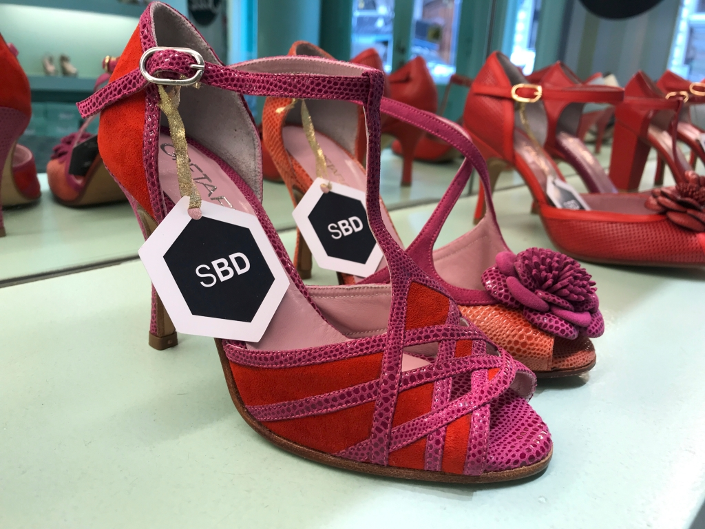 A photo of lovely strappy red and pink tango high heels at the GretaFlora shoe shop in Buenos Aires, Argentina. If you're interested in fashion and stiletto shopping in Buenos Aires, this is one boutique you won't want to miss. Photo Courtesy of FoodWaterShoes
