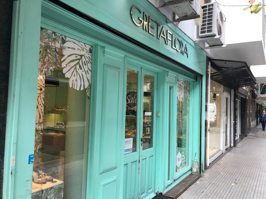 A photo of the front door to GretaFlora, a tango shoe store in Buenos Aires, Argentina. The photo is of the exterior / is an outside street view shot of the high heel specialty boutique. Photo Courtesy of FoodWaterShoes