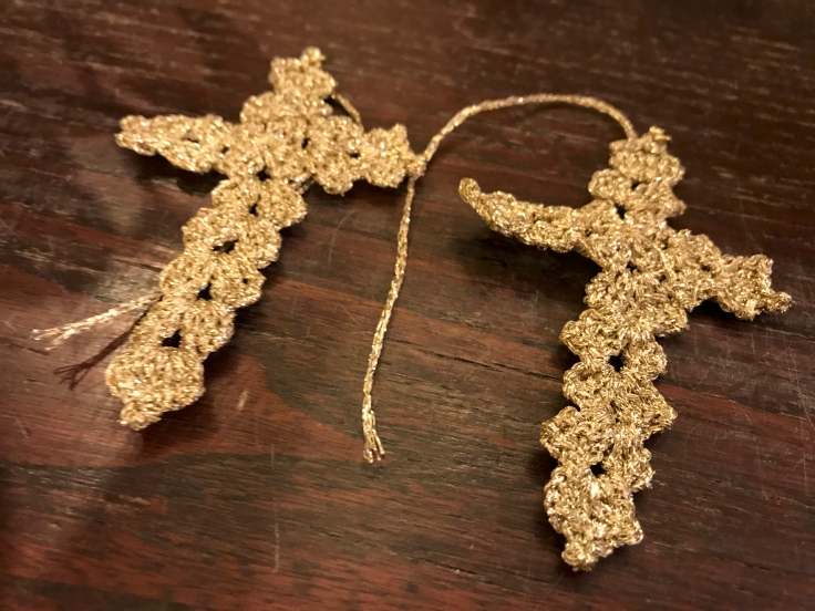 A photo of handmade cross shaped crochet earrings still in the works at Sikuliana Art Atelier in Florence, Italy. Photo Courtesy of FoodWaterShoes