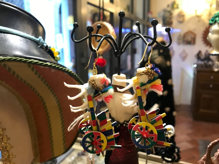 A photo of handmade horse or donkey cart earrings at Sikuliana Art Atelier in Florence, Italy. Photo Courtesy of FoodWaterShoes