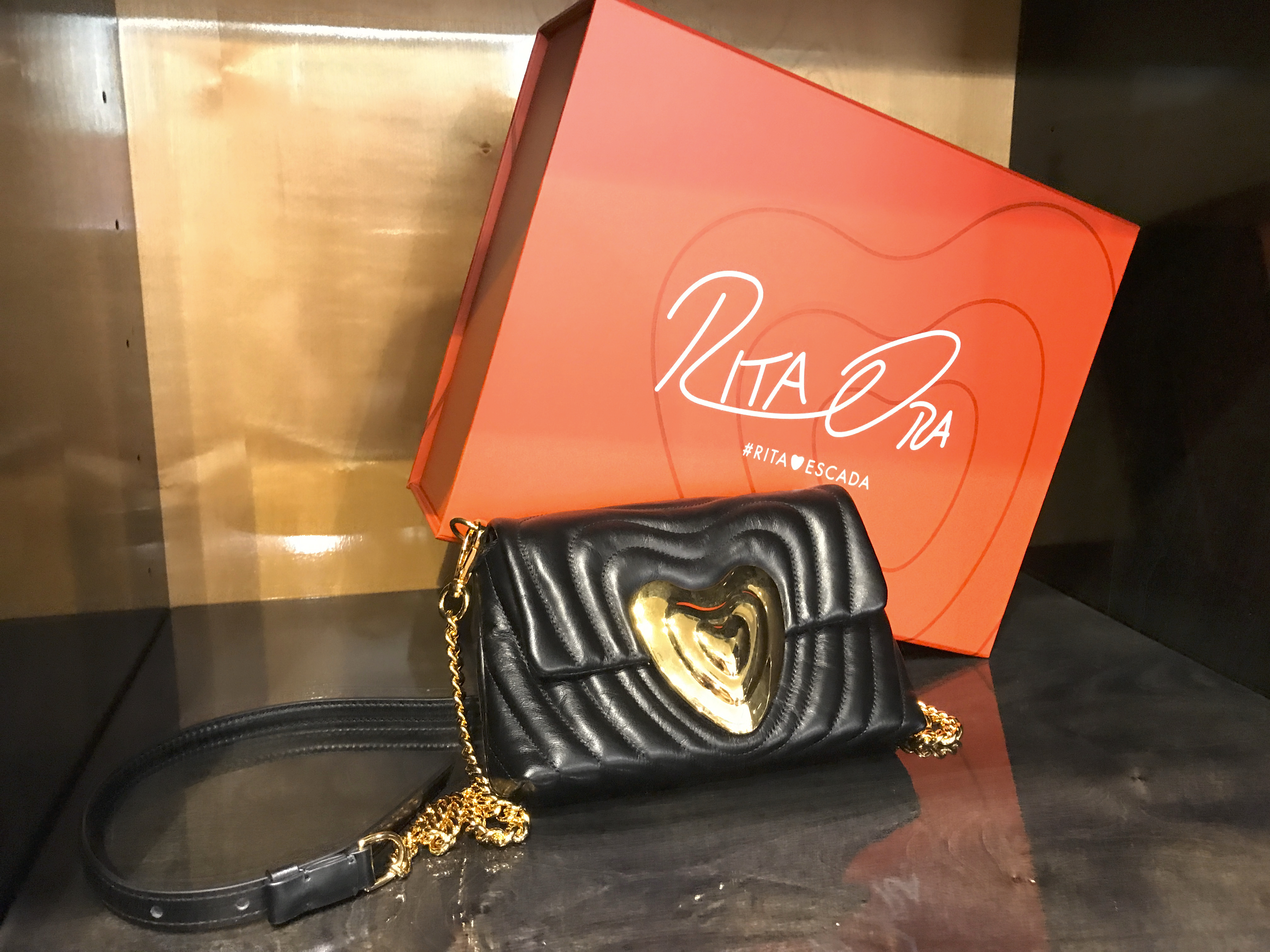 A photo of a Rita Ora designed black leather Escada heart bag at Bottega Giuliana, a cute boutique in Verona, Italy. The rare purse features gorgeous gold accents and hardware. Photo Courtesy of FoodWaterShoes