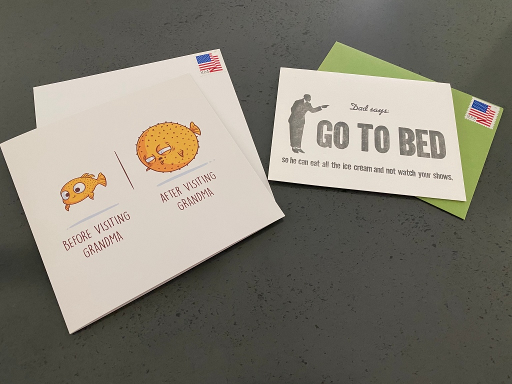 "A photo of a Marcel Schurman greeting puffer fish card that says, ""Before Visiting Grandma,"" and, ""After Visiting Grandma."" There's also a greeting card that says, ""Dad Says Go To Bed So He Can Eat Ice Cream and Not Watch Your Shows,"" from Zeichen Press. Photo Courtesy of FoodWaterShoes"