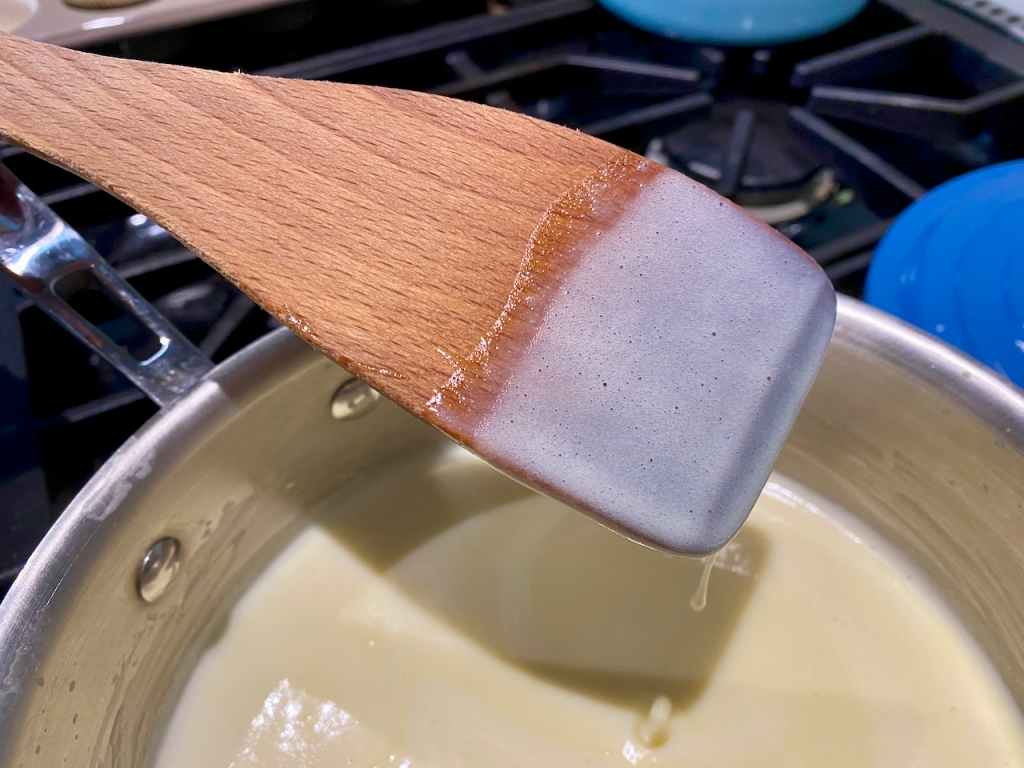 Ice cream base coats the back of a wooden spoon spatula. Photo Courtesy of FoodWaterShoes