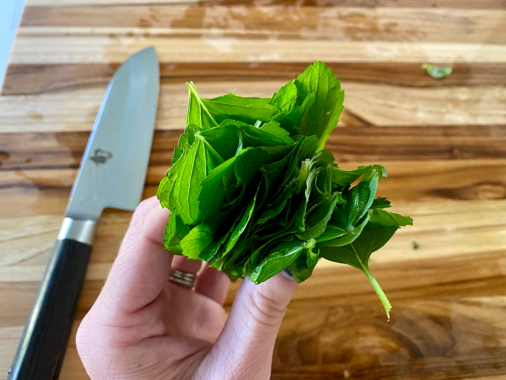 A stack of fresh wild mint leaves prepped for chiffonade. Photo Courtesy of FoodWaterShoes